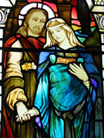 Stained glass window showing Yeshua and Mary