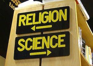 Science/religion sign in a library